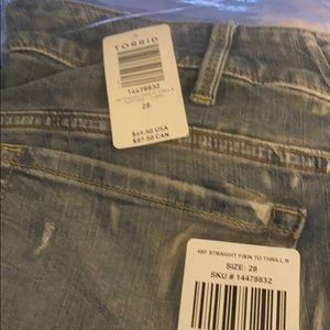 Brand new jeans still in bag from store